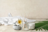 Set of spa supplies on grey background