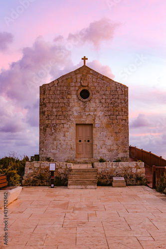 Stampa su Tela View of the St Mary Magdalene Chapel in Dingli at purple sunset, Malta