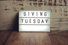 Giving Tuesday Word In Light Box On Wooden Background