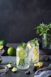 Hard seltzer cocktails with lime and lemon and bartenders accessories