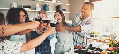 Canvas Print Group of friends cheering at kitchen.