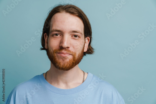 Obraz na plátně Young ginger man with beard posing and looking at camera