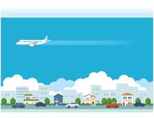 飛行機と街並みのイラスト素材