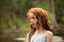 Young Redhead Girl By The Riverside