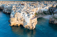 Aerial View Of A Sunset Of Polignano By Sea In Bari. A Village By The Sea In Puglia. Wonderful Landscape