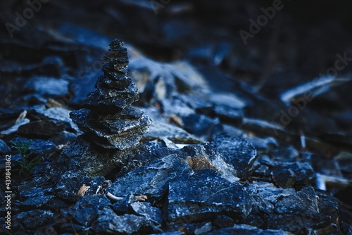 Stones stacked in a tower on a hillside Fototapet