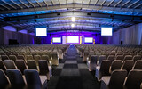 Rows of empty chairs in the large conference hall for corporate convention or lecture