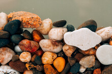 Colorful Sea Pebbles Close-up. Background Texture, Sea Stones In The Water