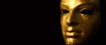 Carnival Gold Face Mask With Eyelashes On Black Background.