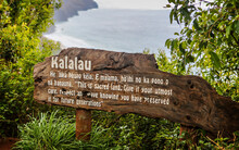 The Sign To The Kalalau Trail With Spectacular Views Of The Kalalau In Kauai, Hawaii, USA.