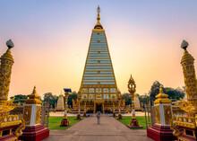 Asian Woman Walking In Golden Stupa Sri Maha Pho Chedi With Colorful Evening Sky At Wat Phra That Nong Bua, Ubon Ratchathani