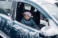 Boy With Santa Hat In Car, Leaving His Cousins.