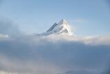 Vast mountain peak surrounded by fog