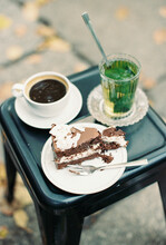 Cake, Fresh Mint Tea And Coffee At A Cafe