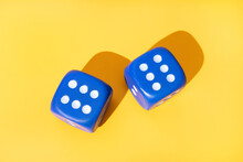 Dice With Row Of Dots On Yellow Background