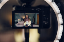 View Of Camera Recording A Video Of A Woman Who Is Vlogging.