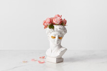 Bust Of Goddess Head With Eye Patches And Flowers
