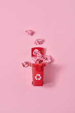 Crumpled Papers In Trash Can On Pink Background