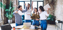 Cheerful Diverse Colleagues Rejoicing Successful Collaborative Business Results