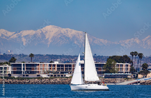 View of the land in Southern California at Marina del Rey with the snow capped mountains in the background.