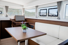 Interior Of Dining Room In Cabin Of Modern Yacht