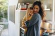 Leinwandbild Motiv Mother consoling her baby