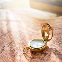 Retro Styled Golden Antique Compass (sundial), Wooden Tall Ship Scale Model And Old White Nautical Chart Close-up. Vintage Still Life. Sailing, Travel, Navigation Concepts. Collecting, Souvenir, Gift