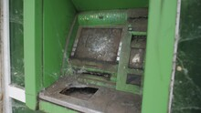 The Collapse Of The Financial System. A Broken, Broken, Mud-covered ATM.
