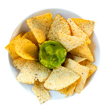 Popular Mexican Guacamole Sauce With Corn Chips Nachos. Isolated Over White Background
