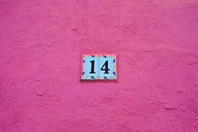 Decorative Number 14, Tiles On Pink Painted Wall.