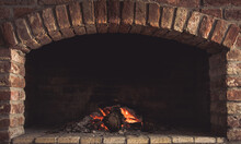 Closeup Shot Of Burning Firewood In A Stone Fireplace