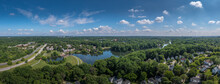 Aerial Panorama Of Single Family Homes And Town House Neighborhoods Around Lake Elkhorn, A Manmade Lake In Owen Brown Village In Columbia Maryland USA
