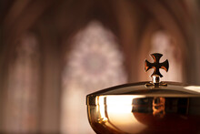 First Holy Communion. Catholic Religion Theme. Crucifix, The Cross And Golden Chalice And Wafer On The Altar In The Church.