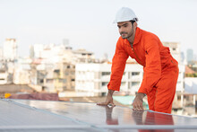 Engineer Or Technician Checking And Looking Solar Panels On The Top Of The Roof