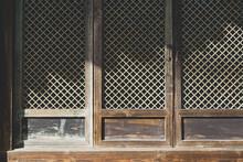 Closeup Shot Of An Old Brown Wooden Gate Partially Under Sunlight