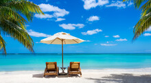 Two Deckchairs On The Idyllic White Beach In Front Of The Turquoise Sea