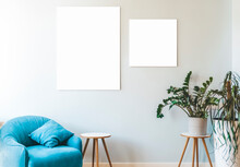 Mock Up Canvas. White Blank Canvas Frame On The Wall In A Light Minimalistic Interior. Design And Decoration Of A Room Or Office Interior