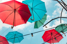 Colorful Umbrellas In The Sky. Multicolored Umbrellas In The Sky, Creating A Summer, Art Mood On The Street