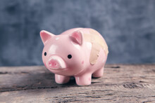 Bandage On A Piggy Bank