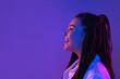 Leinwandbild Motiv Young woman's portrait on gradient colors studio background in neon. Concept of human emotions.