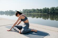 Graceful Brunette Doing Yoga In A Scenic Beautiful Spot On A Riverside