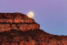 Full Moon Rising Behind Rocky Hill