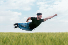 Casual Superhero Flying Above Field Grass