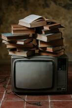 Stack Of Books On Retro TV