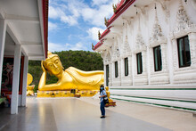 Asian Travelers Thai Women Travel Visit And Respect Praying Buddha Reclining Attitude Statue Of Wat Khao Sung Chaem Fa Temple On Khao Sam Sip Hap At Tha Maka On May 23, 2021  Kanchanaburi, Thailand