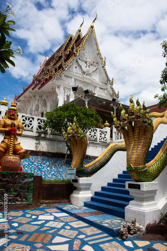 Fotografiet Ancient ruins building naga stairs of Wat Khao Sung Chaem Fa temple for thai peo