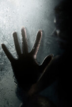 Silhouette Hand On Frosted Glass