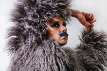 Man In Fur Coat Looking Away Against White Background