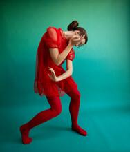Female Ballet Dancer Dancing Against Turquoise Background