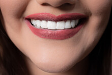 Woman With Red Lipstick And Toothy Smile